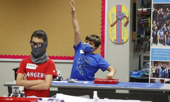 WHO: Children aged 6-to-11 should wear masks at times