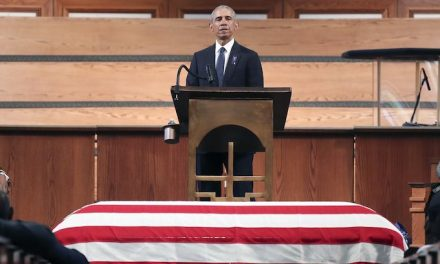 Obama blatantly political as he stands over John Lewis' coffin