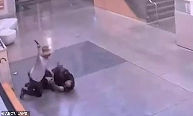 Video shows attack on LA officer inside police station