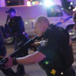 Two police officers shot in Louisville race riot