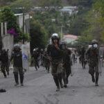 Guatemalan forces disperse migrant caravan on highway