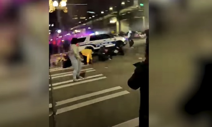 Tacoma police officer drives through crowd trying to break out his windows