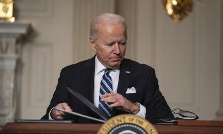 Under pressure Biden to hold first formal news conference next week