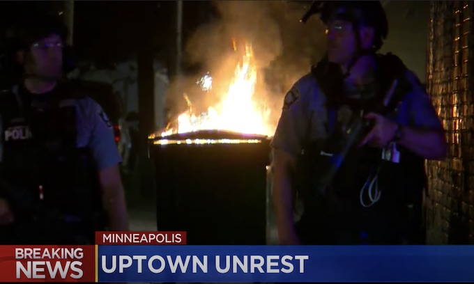 Man who drove at Minneapolis protesters charged with murder
