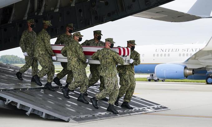 Biden attends dignified transfer of troops slain in Afghanistan