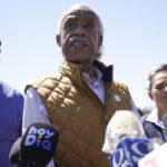 Al Sharpton heckled by protesters yelling 'we don't want your racism in Texas' forcing him to cut short his speech at Del Rio